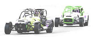 two caterham cars racing